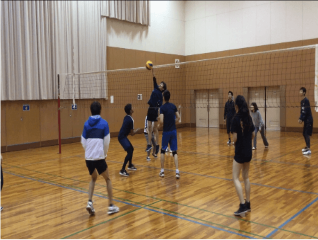 tourists playing volleyball in osaka