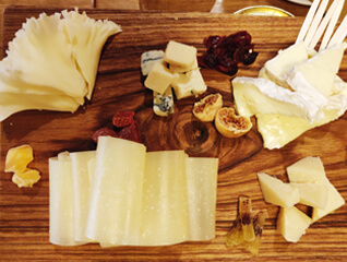 different cheeses served on cutting board