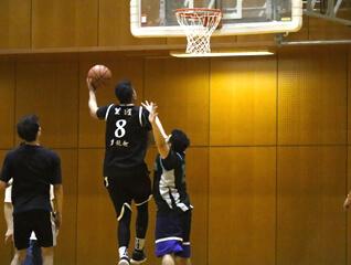 dribbling basketball indoors at osaka gym